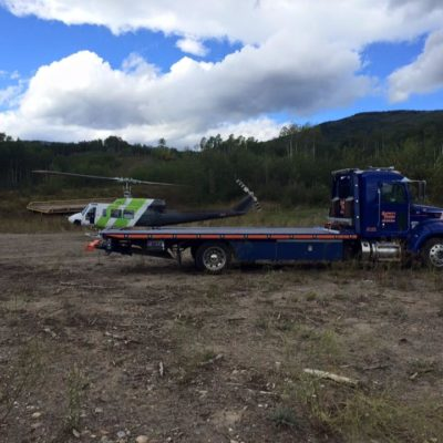 Helicopter recovered a Jeep for a client to bring it off the mountainside to our deck truck.