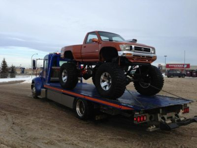Single Axle Deck Truck hauling custom show Toyota