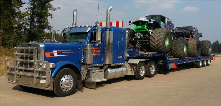Semi Hauler Towing Two Monster Trucks in Grande Prairie, AB