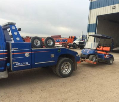 1-Ton Wrecker towing golf cart