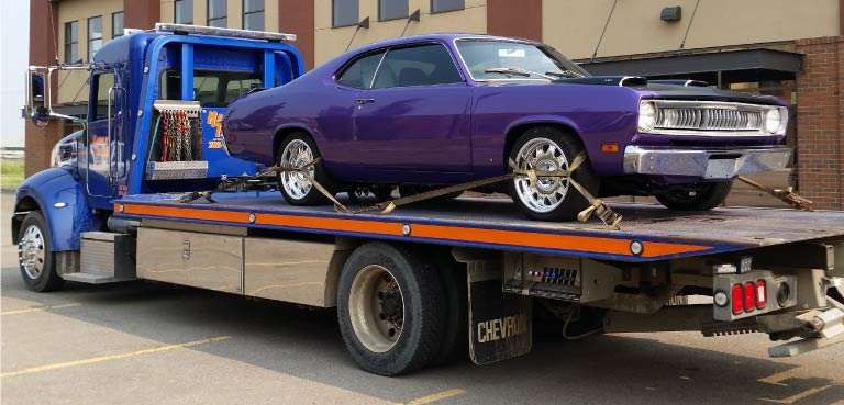 Flatdeck Specialized Towing a Classic Car in Grande Prairie, AB