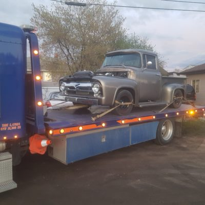 A classic being returned to its owner after is restoration.